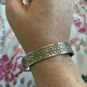 Authentic Coach signature silver bangle